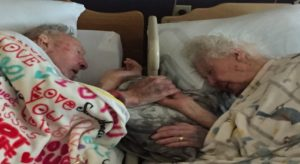 In Their Final Act Of Love, Husband Holds Wife's Hand In Her Final Moments